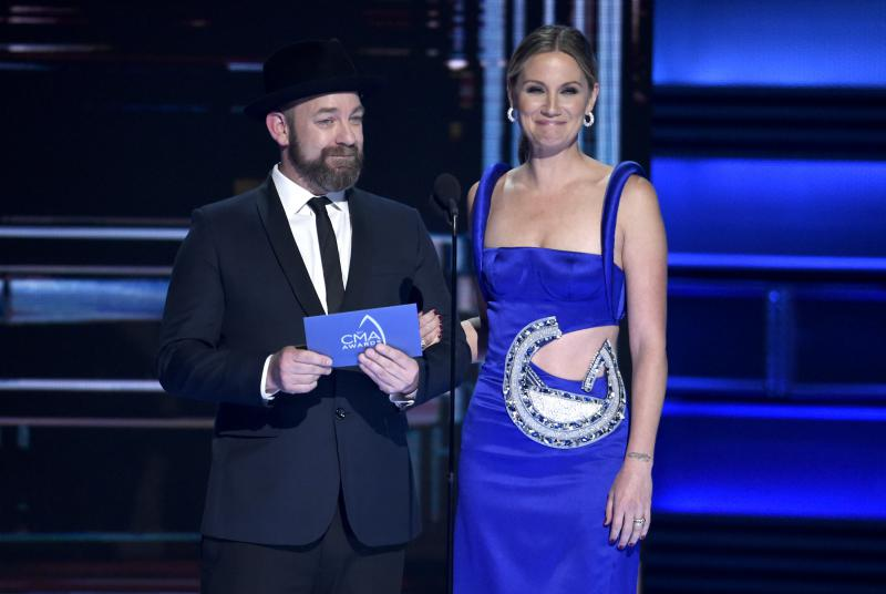 Kristian Bush, left, and Jennifer Nettles present the award for vocal duo of the year at the 51st annual CMA Awards at the Bridgestone Arena on Wednesday, Nov. 8, 2017, in Nashville, Tenn.