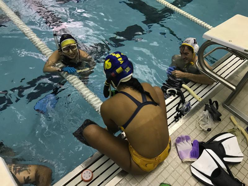 Underwater hockey players catch their breath between sets at Atlanta's Washington Park Natatorium.