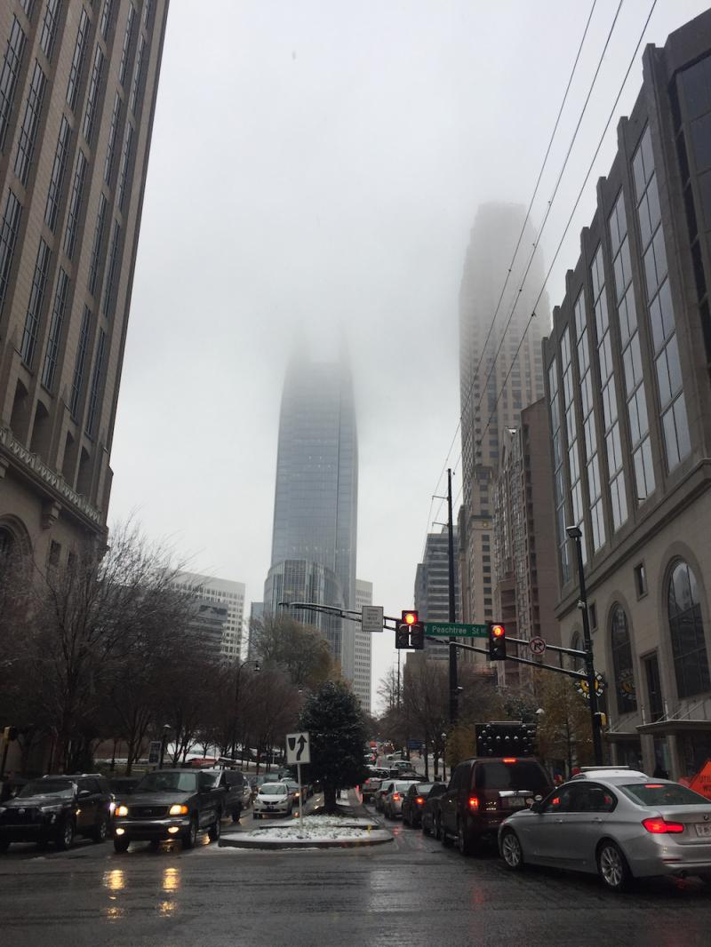 The streets of Midtown Atlanta are snarled Friday afternoon as a wintry mix of snow and rain falls.