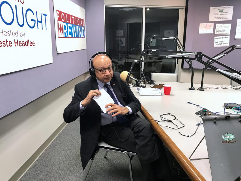 Khizr Khan at the GPB studios, holding his pocket copy of the U.S. Constitution.