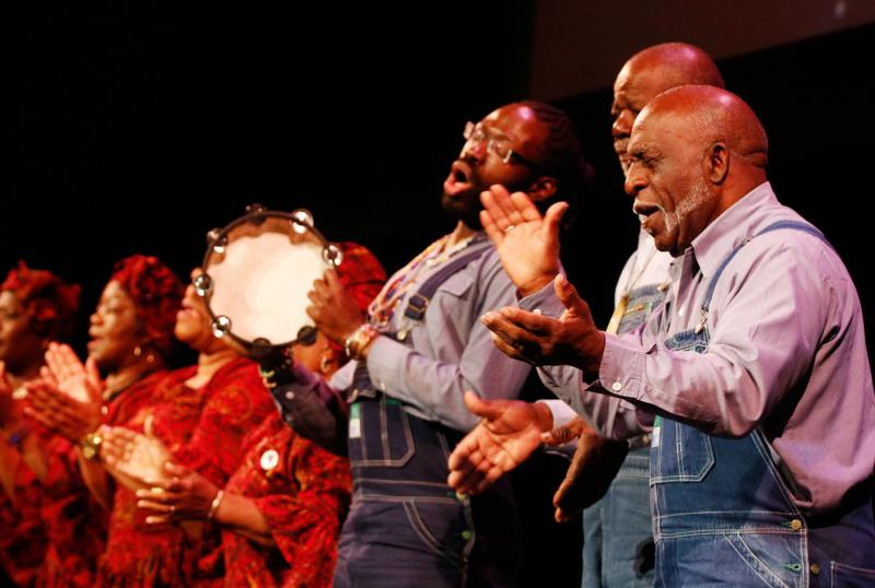 Freddie Palmer, right, leads the McIntosh County Shouters during a recent performance at the Lucas Theatre in Savannah.