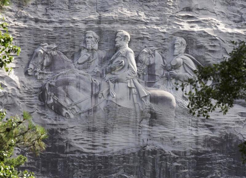 This June 23, 2015 file photo shows the carving depicting Confederate Civil war figures Stonewall Jackson, Robert E. Lee and Jefferson Davis, in Stone Mountain, Ga.