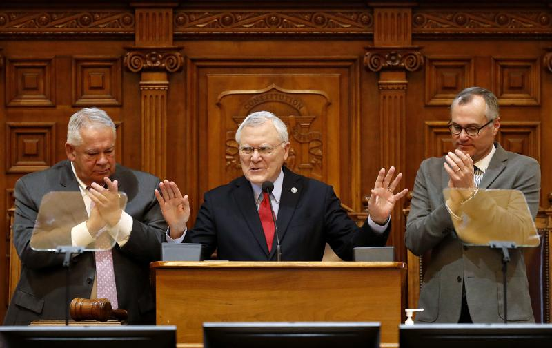 Georgia Gov. Nathan Deal delivers the State of the State address on the House floor while applauded by Lt. Gov. Casey Cagle, right, and House Speaker David Ralston at the state Capitol in Atlanta, Thursday, Jan. 11, 2018.