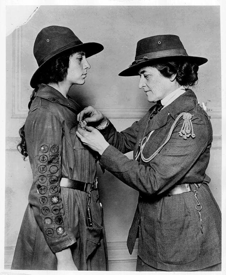 Juliette Gordon Low officiates a Girl Scout.