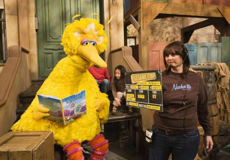 Lynn Finkel, stage manager for Sesame Street, slates a taping with Big Bird on Thursday, April 10, 2008 in New York. Puppeteer Caroll Spinney has worked on Sesame Street for years playing both Big Bird and Oscar the Grouch.