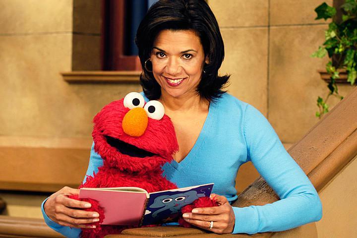 """Sonia Manzano, as Maria, with Elmo on """"Sesame Street."""""""