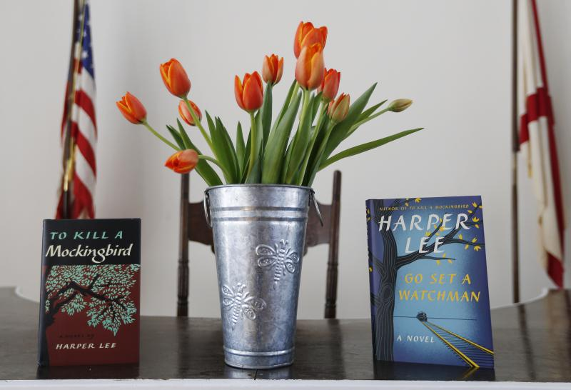 "Harper Lee's two books, ""To Kill a Mockingbird,"" and ""Go Set A Watchman"" are displayed with a bouquet of tulips in the Monroe County Heritage Museum old courthouse Friday, Feb. 19, 2016, in Monroeville, Ala."