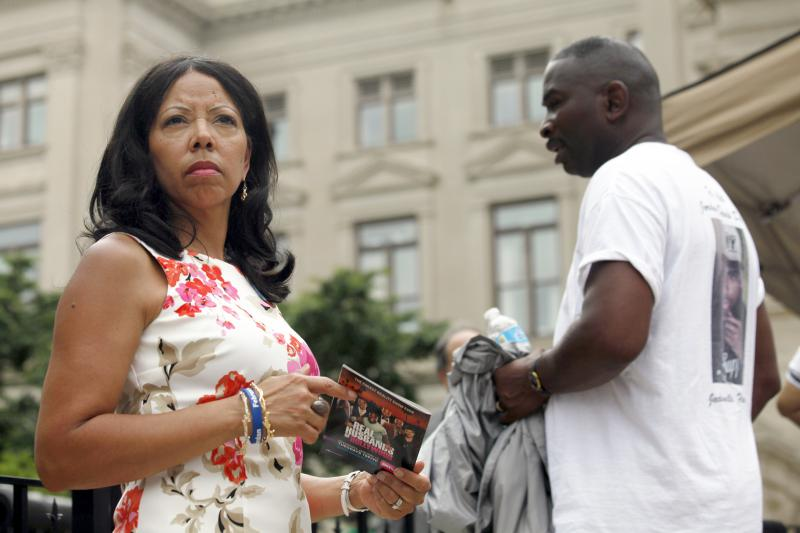"Lucy McBath, left, and her husband Ron Davis participate in a gun control rally as part of the ""No More Names: National Drive to Reduce Gun Violence,"" at the Georgia Capitol, June 24, 2013, in Atlanta."