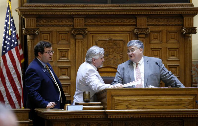 Sen. Josh McKoon, R-Columbus, left, and Sen. Greg Kirk, R-Americus, confer with Senate President Pro Temper David Shafer, R-Duluth, on the Senate floor, March 24, 2016, in Atlanta.
