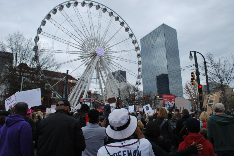 Crowds make their way past Atlanta's Olympic Centennial Park.