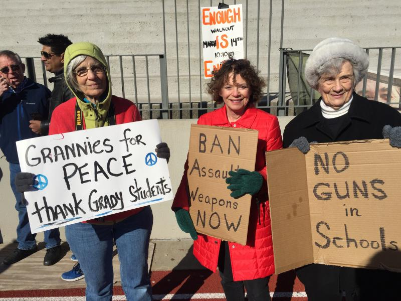 Women from the advocacy group Grannies for Peace support Grady students from the sidelines during their walkout.