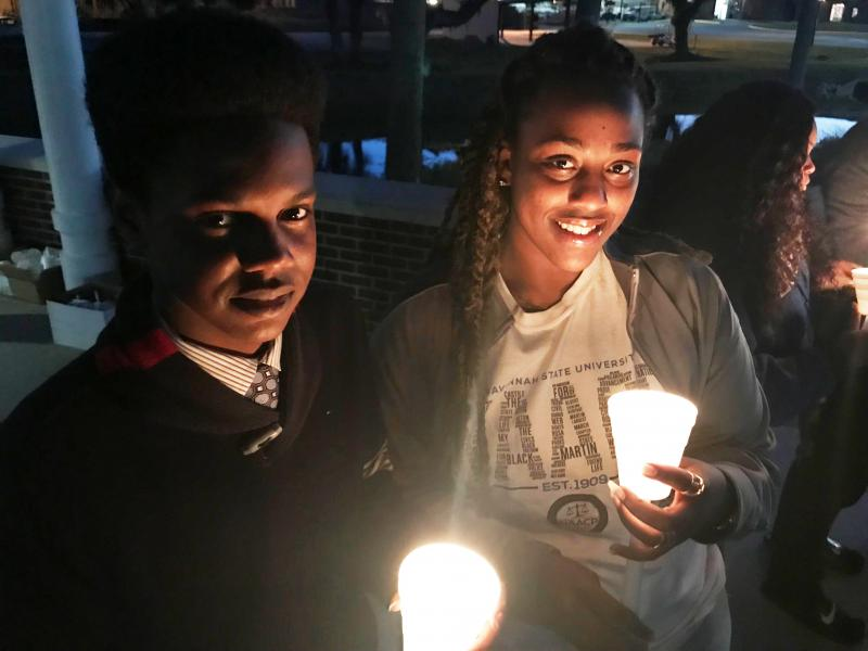 Savannah State students Schonn Franklin and Haley Swindle at a candlelight vigil to memorialize victims of gun violence on campus.