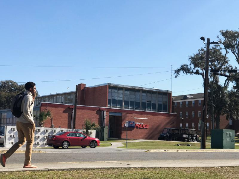 A Savannah State student walks past campus police headquaters. After a fatal shooting in February 2018 the University system of Georgia sent in officers from other campuses.
