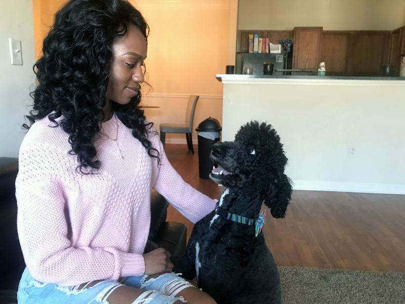 Paige Bullard and her dog Charlie. She dropped out of Savannah State after surviving an armed attack at the student housing complex.