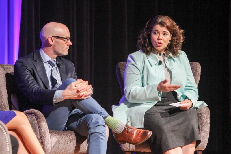 Celeste Headlee hosts a panel about workplace diversity on Feb. 21, 2018 at the Carter Center in Atlanta. Listening to her is Scott Page, a diversity expert at the University of Michigan.