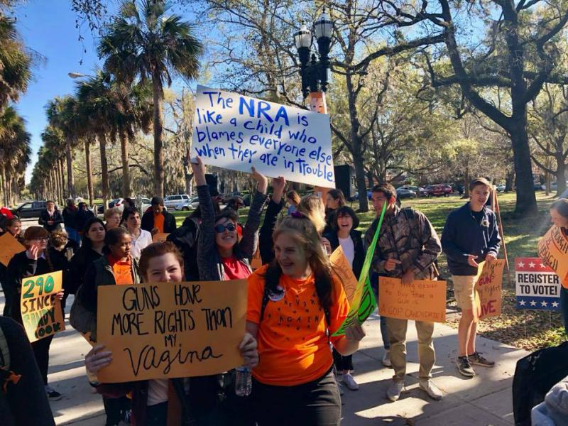 Students march down the streets in Savannah in protest of gun violence