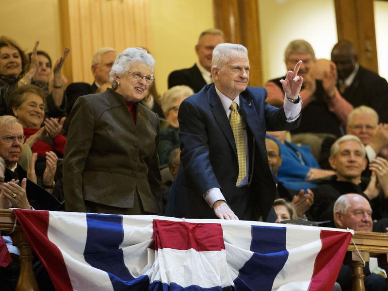 Former Georgia Governor Zell Miller, right, waves when acknowledged with wife Shirley during an inaugural ceremony for Georgia Gov. Nathan Deal at the state Capitol, Monday, Jan. 12, 2015, in Atlanta.