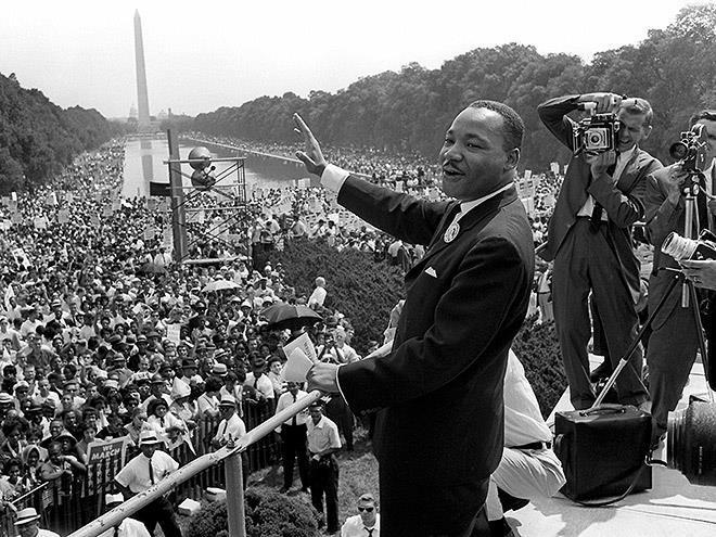 Historic photo of Martin Luther King Jr. addressing a crowd at Washington Monument.