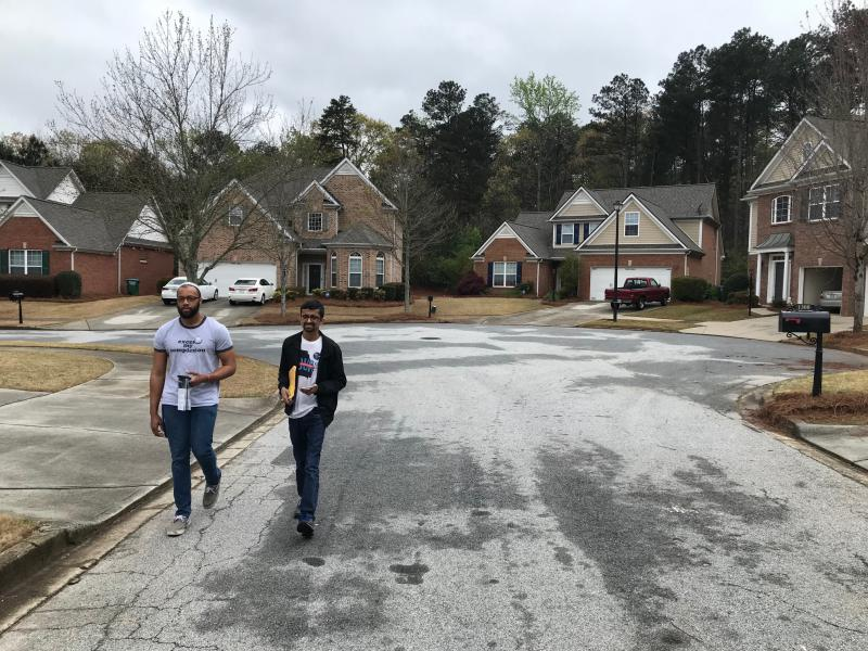 Daniel Hilton and Krupesh Patel knock on doors in a Snellville neighborhood, trying to rally enthusiasm for primary voting in Gwinnett County.