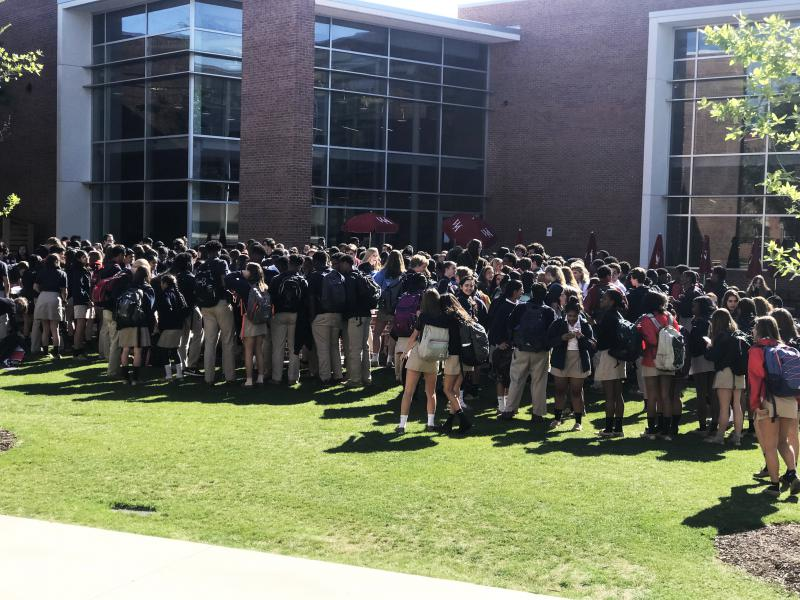 Students walk out of Woodward Academy in College Park.