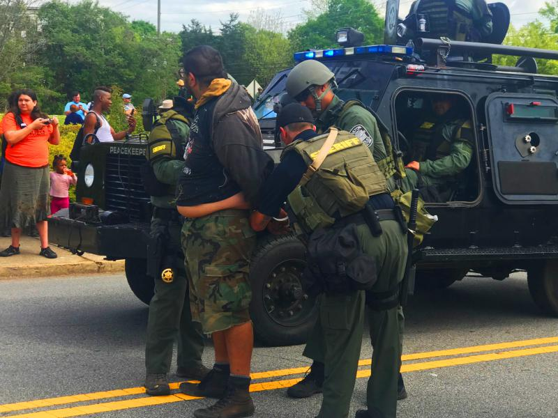 At least ten counter-protesters were arrested Saturday, CBS affiliate WGCL reported.