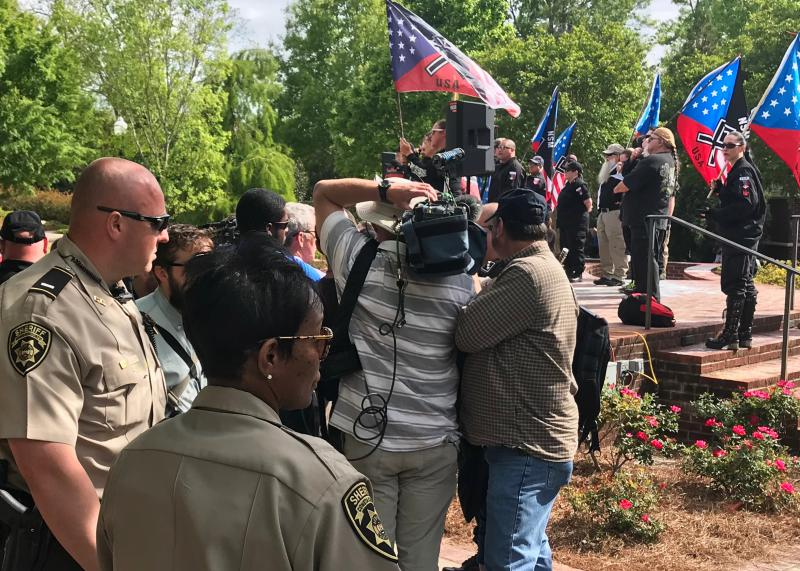 Police provided security for neo-nazi organizers. Officers didn't let anyone besides NSM organizers and credentialed media inside the park where the rally timed to celebrate Hitler's birthday took place.