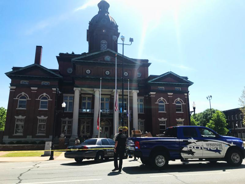 Law enforcement blocked access to the Coweta County Courthouse, which is ringed in Confederate monuments.