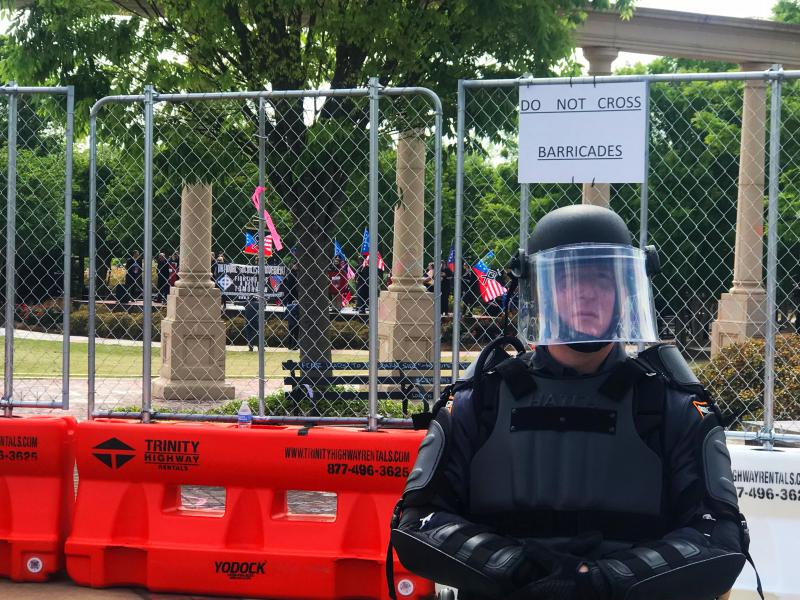 Georgia State Patrol in riot gear kept a 75 yard buffer between speakers at a National Socialist Movement rally in Newnan, and hundreds of counterdemonstrators.