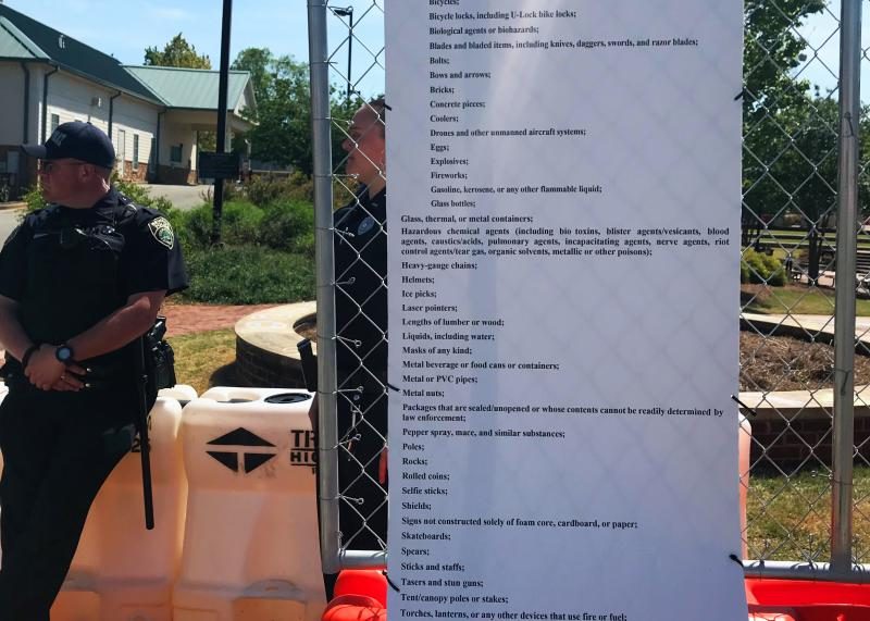 The list extensive list of items banned in rally and counterprotest areas did not include loaded guns.