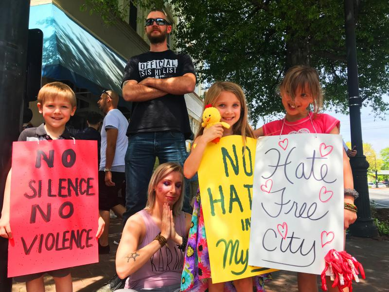 Brad and Ashley Strange brought their kids out to demonstrate on Newnan's historic square.
