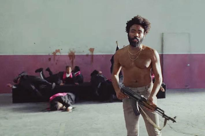 "Childish Gambino shoots a choir of black singers in the ""This is America"" music video, echoing the Charleston church shooting of 2015"