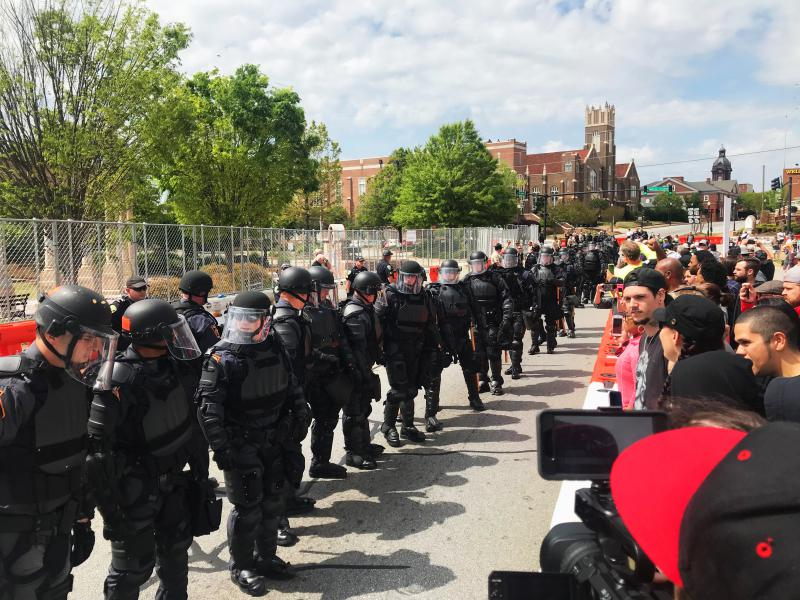 Georgia State Patrol in riot gear kept protestors 75 yards away from a National Socialist Movement rally in Newnan's Greenville Park on April 21, 2018.