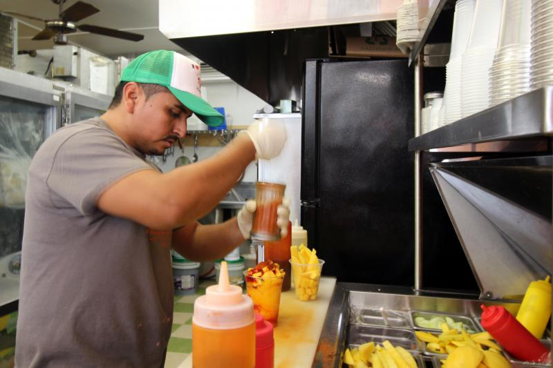 Adrian Saucedo-Luviano prepares a fruit smoothie for a customer at La Calentana, the bakery and takeout restaurant he owns and operates in Tifton. He is awaiting his date in immigration court after being arrested in Houston County.