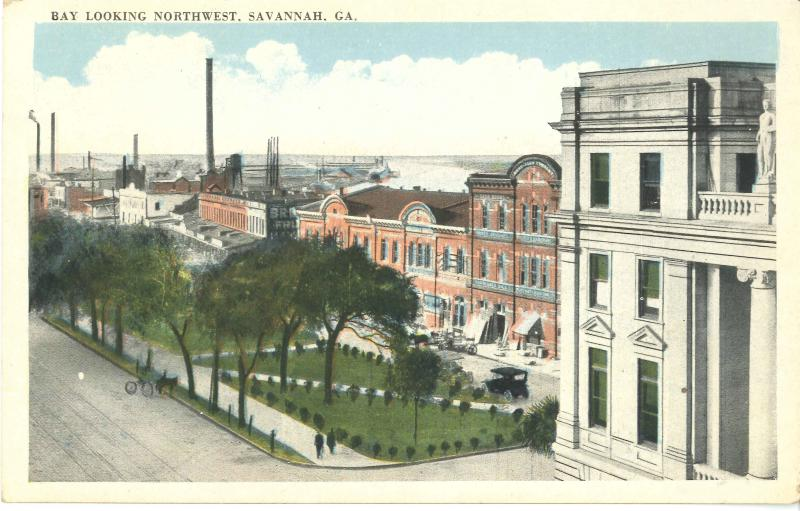 This historic view of Bay Street, with City Hall in the foreground, shows the brick buildings that once lined the street.