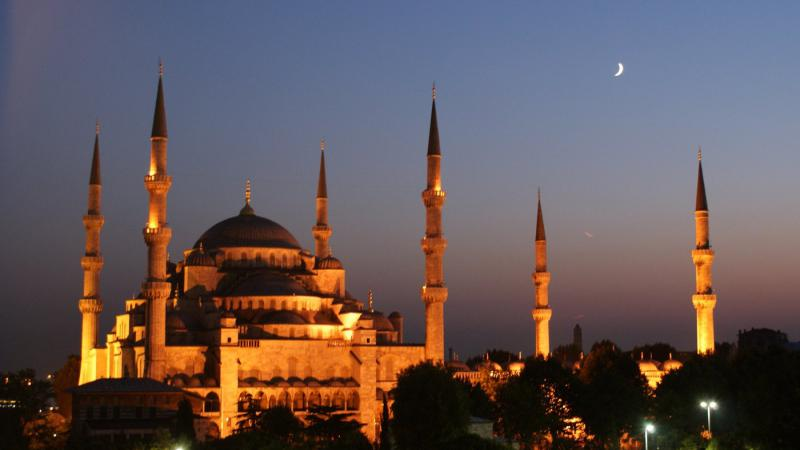 A crescent moon rises over the famous Blue Mosque in Istanbul, Turkey.