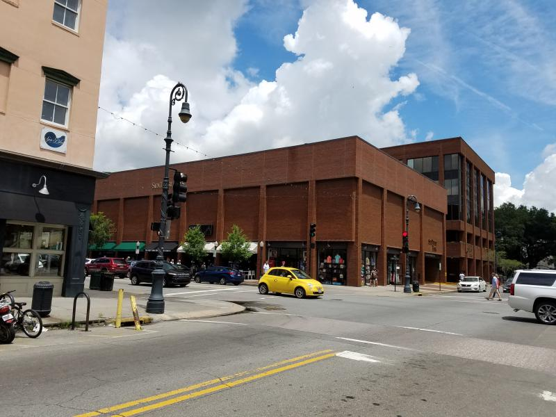 Today, a pahrking garage with first-floor retail space, and a SunTrust bank beyond, occupies the corner of Bull and Broughton.
