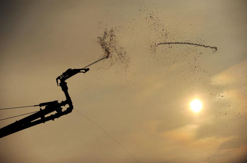 An agricultural irrigator fueld by the Flint River waters down a peanut field near Colquitt during a drought in 2011.