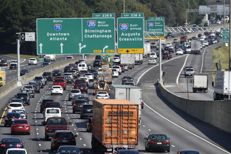 Heavy traffic on Interstate 75 moves slowly, Friday, Sept. 8, 2017, in Forrest Park, South of Atlanta.