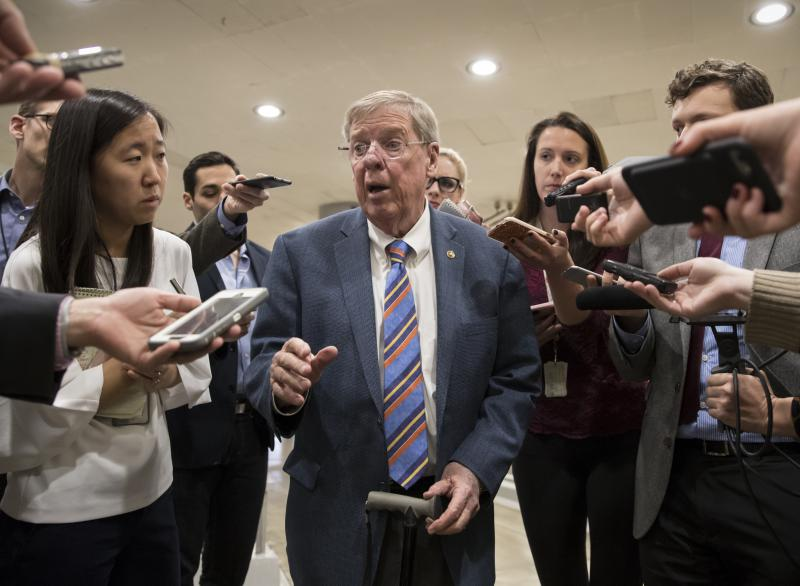 Sen. Johnny Isakson, R-Ga., a member of the tax-writing Senate Finance Committee, takes questions from reporters as he and other lawmakers head to the Senate floor for votes on Capitol Hill in Washington, Monday evening, Nov. 27, 2017.