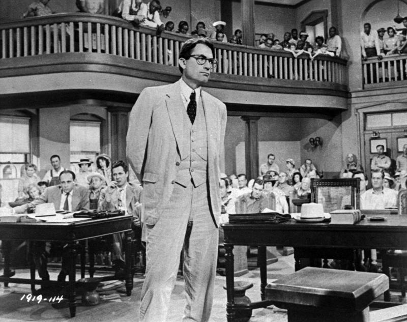 "In this 1962 file photo originally released by Universal, actor Gregory Peck is shown as attorney Atticus Finch, a small-town Southern lawyer who defends a black man accused of rape, in a scene from ""To Kill a Mockingbird."""