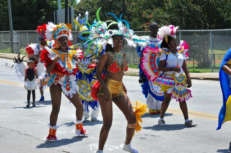 Saturday's parade had many men and women dressed in Afro style fashion. Traditional bongo drums and music played in the background as the parade dancers boogied down Martin Luther King Jr. Drive.