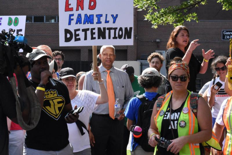 Rep. Hank Johnson joins the crowd during the Atlanta Families Belong Together march Saturday June 30.