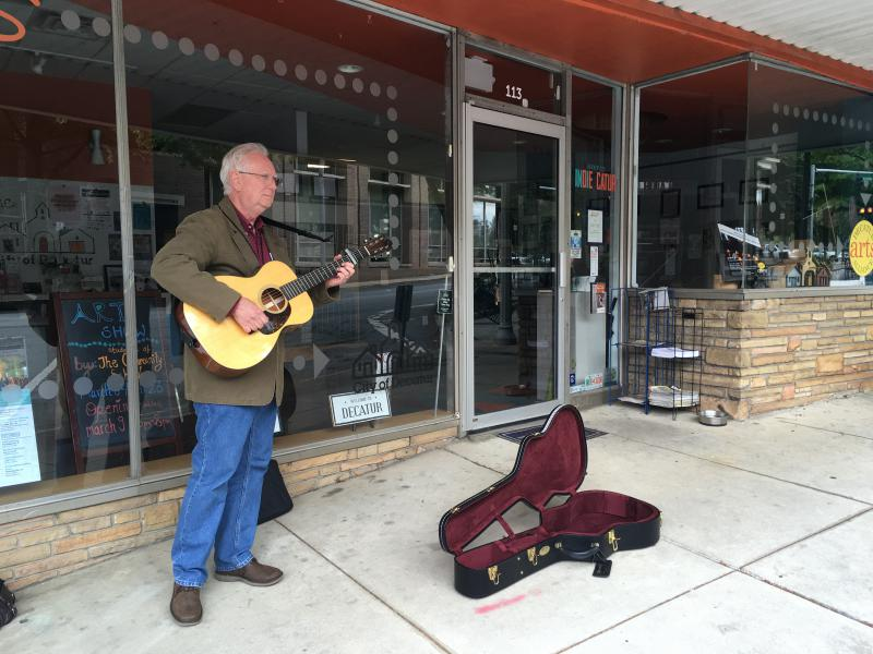 Jim Anderson plays for tips and performance practice in Decatur