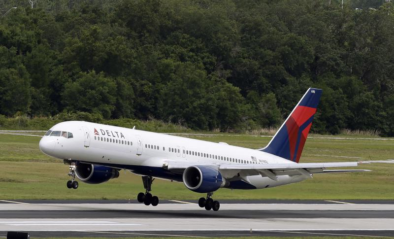 FILE - In this Thursday, May 15, 2014, file photo, a Delta Air Lines Boeing 757-232 lands at the Tampa International Airport in Tampa, Fla.