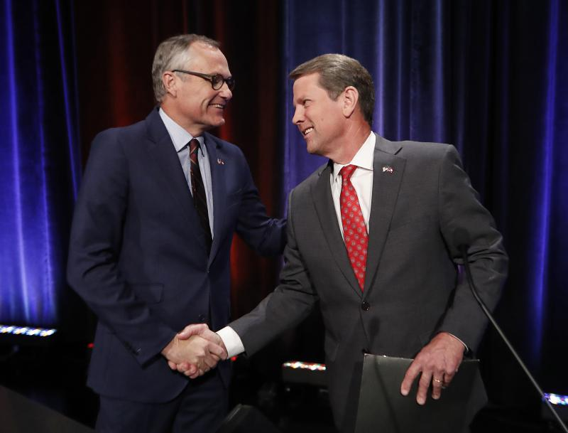 In this July 12, 2018, file photo, Georgia Republican gubernatorial candidates, Lt. Gov. Casey Cagle, left, and Secretary of State Brian Kemp shake hands after an Atlanta Press Club debate at Georgia Public Television in Atlanta.