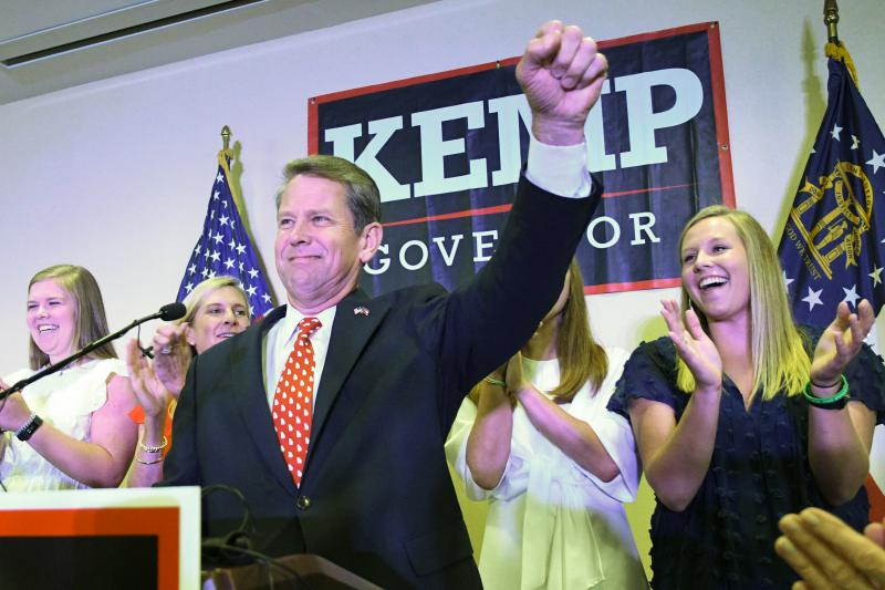 Georgia Republican gubernatorial runoff candidate Brian Kemp goes on stage to declare victory against Casey Cagle during an election night party, Tuesday, July 24, 2018, in Athens, Ga.