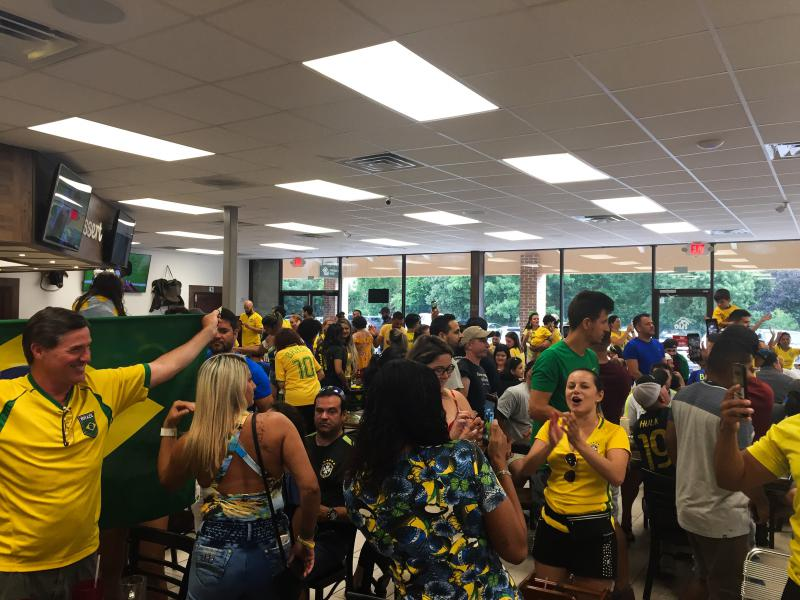 The crowd of hundreds at Rio Steakhouse and Bakery in Marietta, Georgia cheers after Brazil advances to the World Cup round of eight.