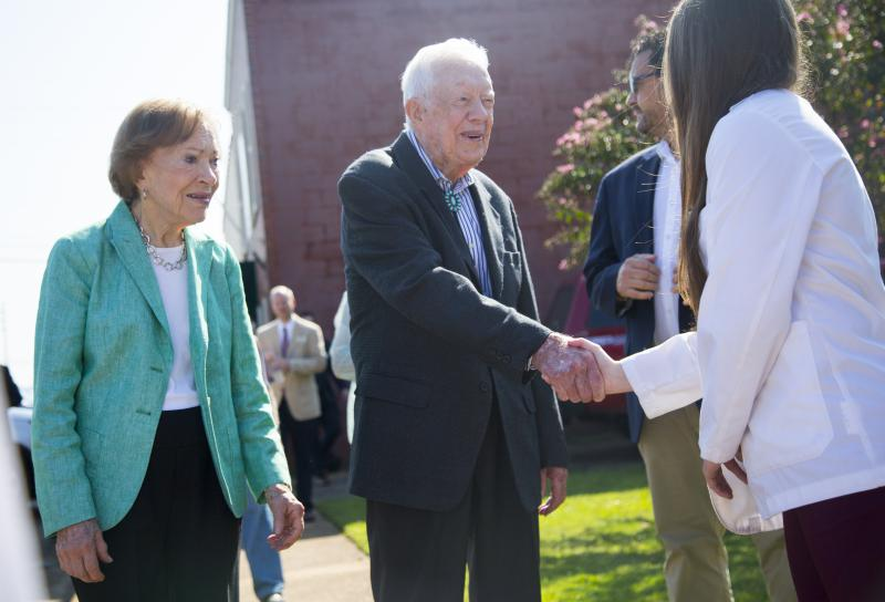Rosalynn and Jimmy Carter greet one of the Mercer University medical students on hand to officially open the new Mercer medical clinic in the Carters' home of Plains.