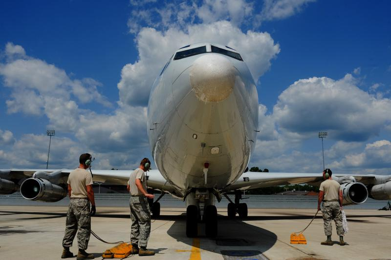 JSTARS aircraft crew chiefs recover an E-8C Joint STARS returning from a mission in 2012.