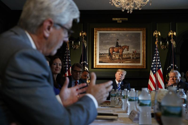 President Donald Trump and Governor Nathan Deal during a meeting with state leaders about prison reform, Thursday, Aug. 9, 2018, at Trump National Golf Club in Bedminster, N.J.